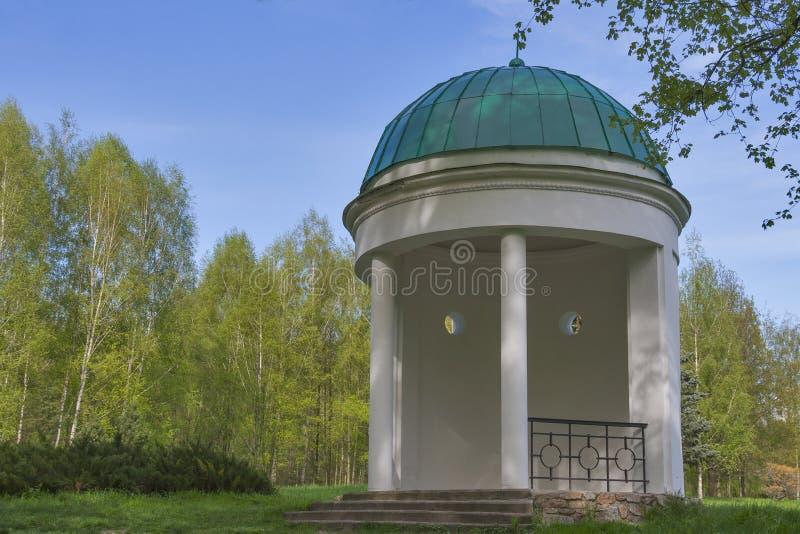 Old spring park with stone gazebo. Closeup royalty free stock photos