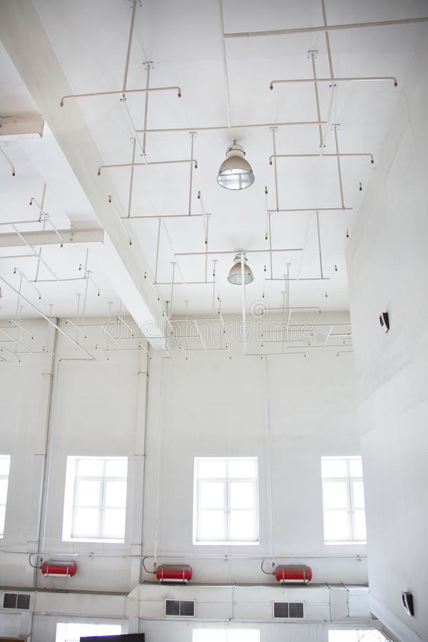 Old sprinkler system on the ceiling of the production room. Fire alarm system, old sprinkler system in the ceiling of the production room royalty free stock photo