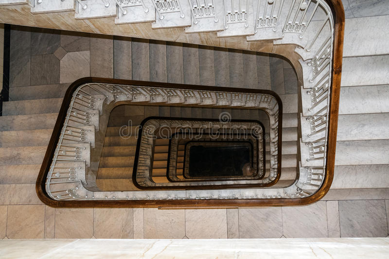 Old square spiral stairway case from above royalty free stock images