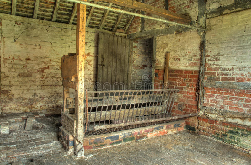 Old stable. Interior view of old farm stable, Worcestershire, England stock images