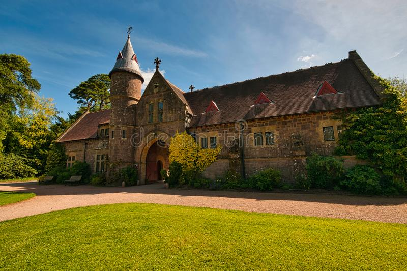 The Old Stables at Knightshayes. The Stables at Knightshayes Balham Tiverton Devon.iStarted in 1869 the house is the work of William Burges who is famed for his stock photo