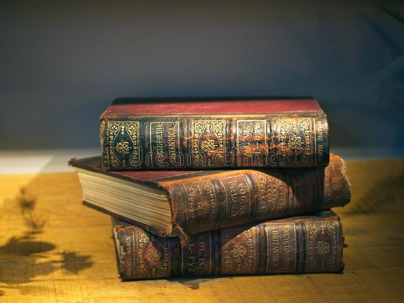 Old stacked books Encyclopaedia Britannica. With red and gold retro cover stock photos