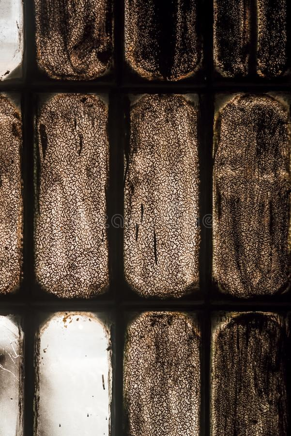 Old stained glass window in the dust royalty free stock images