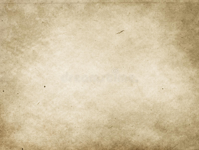 Old stained and yellowed paper texture. stock image