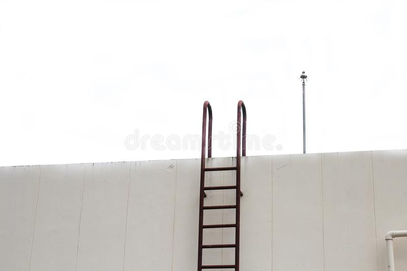Old Stair vertical industrial metal rusted to water tank royalty free stock image
