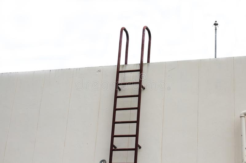 Old Stair vertical industrial metal rusted to water tank royalty free stock images