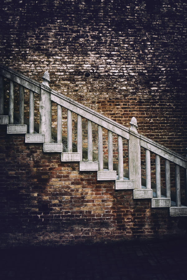 Old staircase on a red brick building royalty free stock photography
