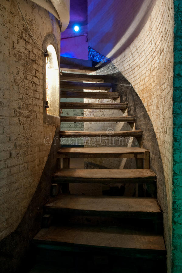 Old stairway. An old stairway to the blue floor royalty free stock image
