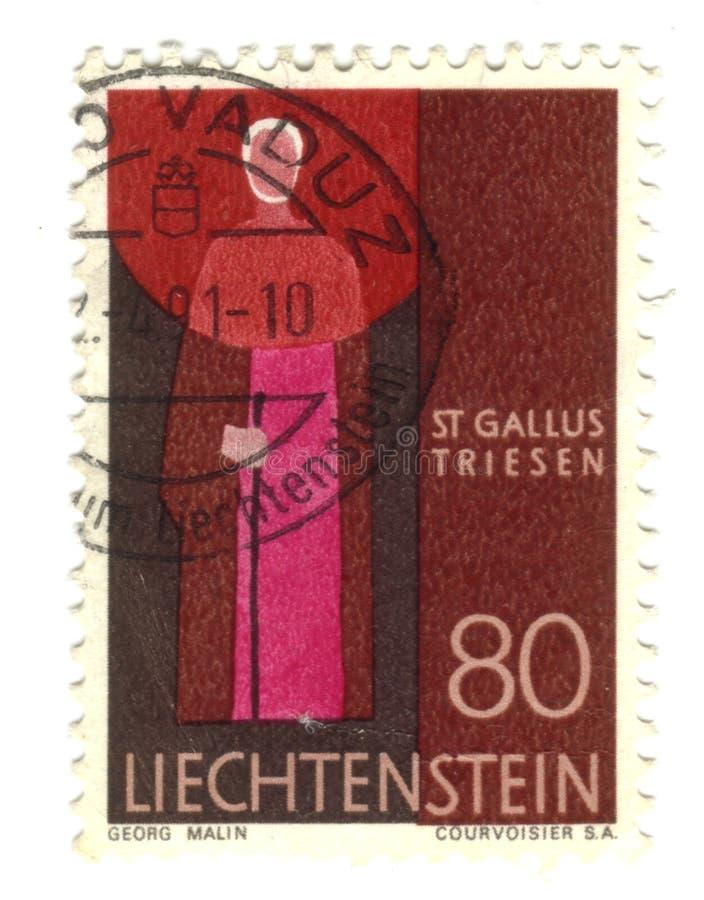 Old stamp from Liechtenstein. With saint Gallus royalty free stock photo