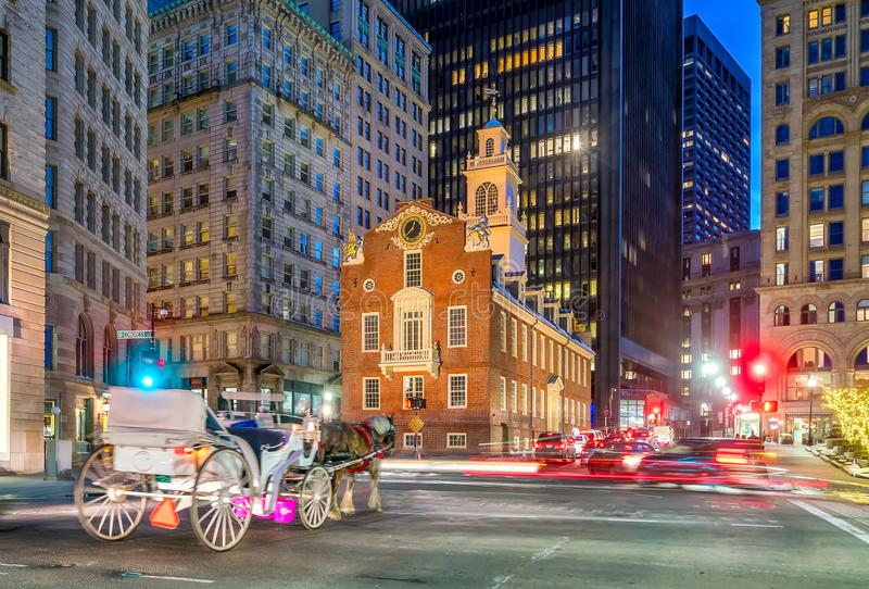 Old State House and moving blurr carriage at twilight in Boston royalty free stock images