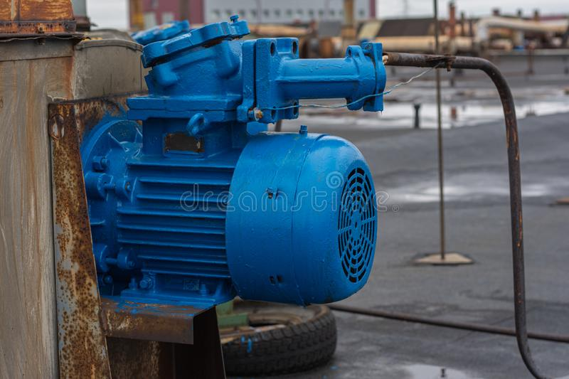 Old stationary engine cleaned and painted blue. engine exhaust system. royalty free stock photos
