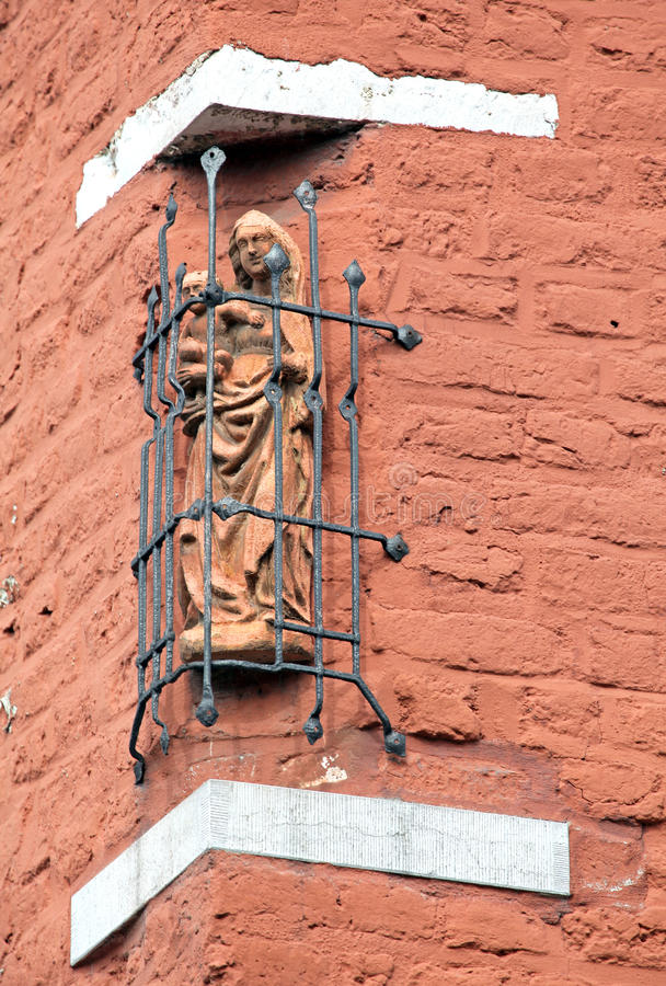 Old statue at the building - Aachen, Germany royalty free stock photography