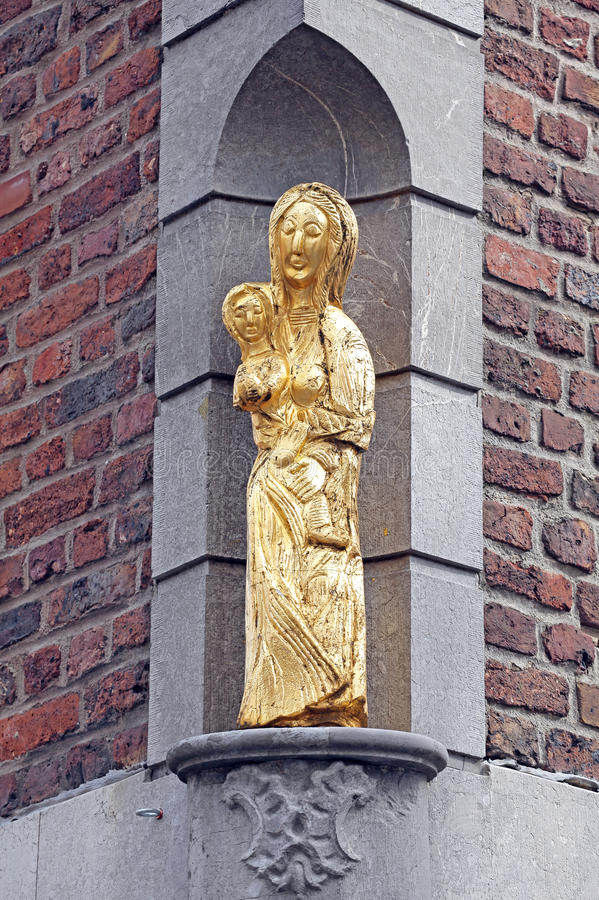 Old statue at the building - Aachen, Germany royalty free stock image