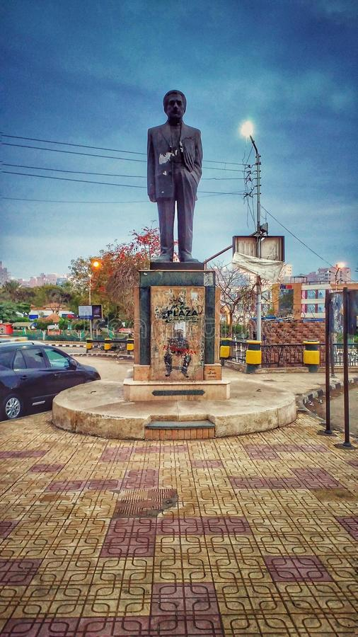 An old Statue , mansoura city , egypt. An old Statue of an egyptian author & x28; Anis Mansour & x29 stock images
