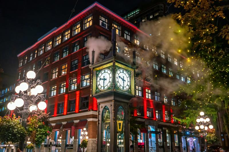 Old Steam Clock in Vancouver`s historic Gastown district at night. In Canada stock image