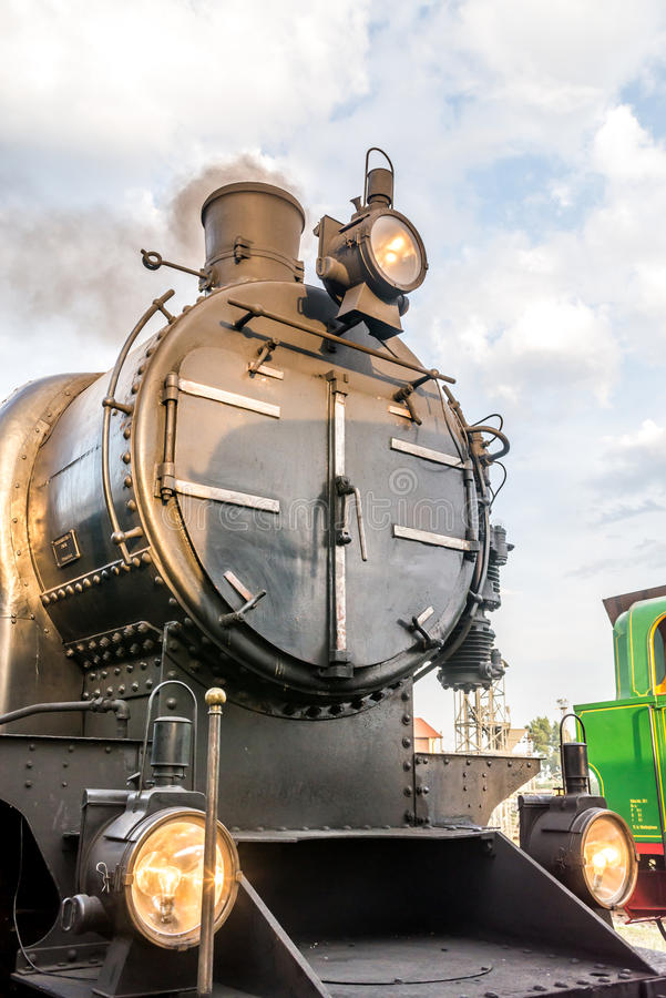 Old steam engine, front view stock image