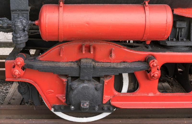 Old steam locomotive. Detail and close up of huge wheels. stock images