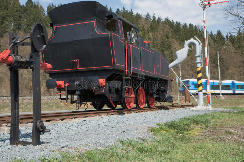 The old steam locomotive and modern train stock photos