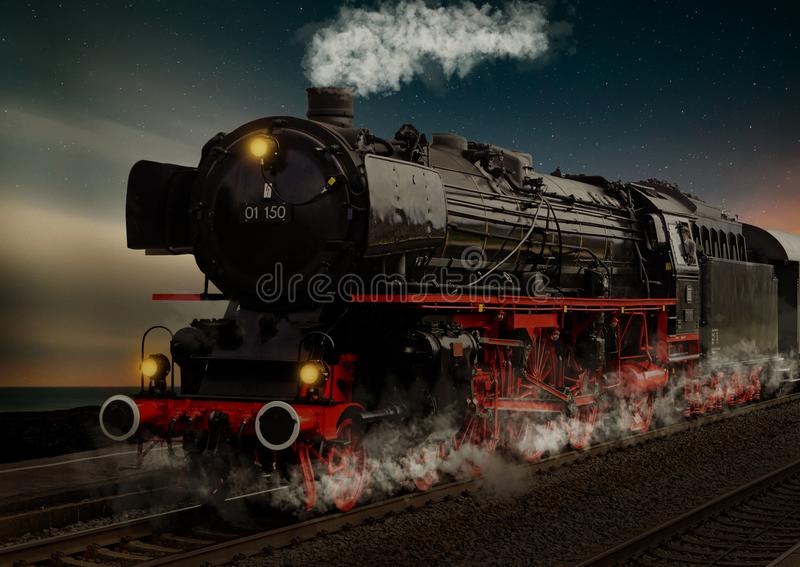 Old steam locomotive at night in Germany stock photos