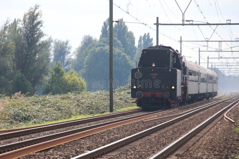 Old steam locomotive running on the track at Nieuwerkerk aan den Ijssel stock images