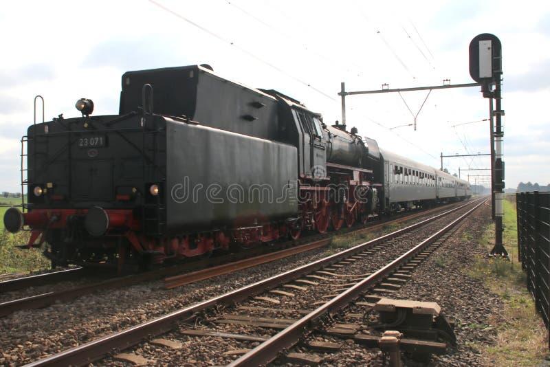 Old steam locomotive running on the track at Nieuwerkerk aan den Ijssel stock photos