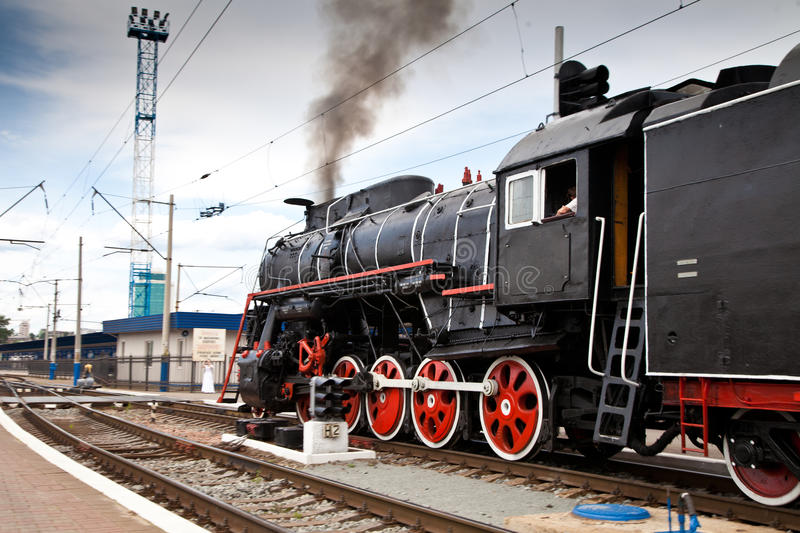 Download Old Steam Train Is Leaving A Station Stock Photo - Image of retro, railway: 25274002