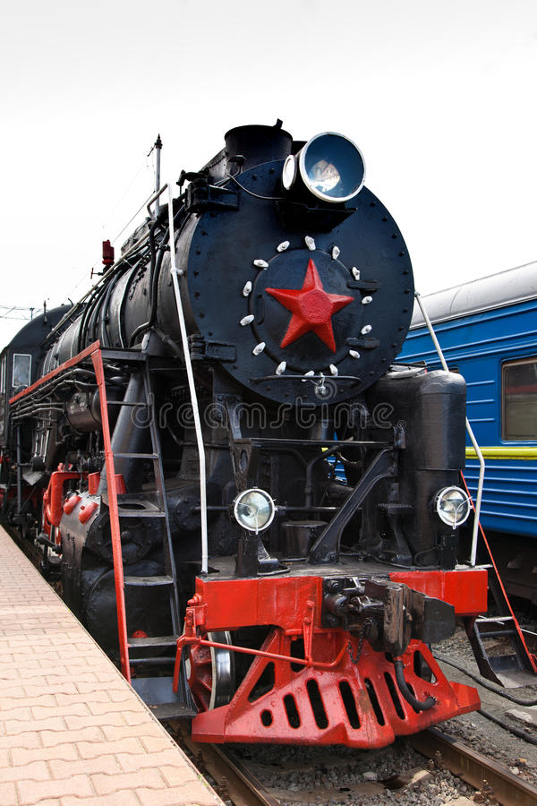 Old Steam Train Is Leaving A Station Royalty Free Stock Photos