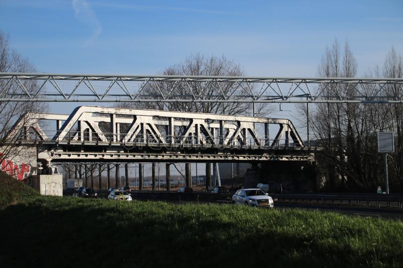 Old steel train bridge over Motorway A12 at Nootdorp used for Randstad rail connection between Rotterdam and Den Haag. royalty free stock image