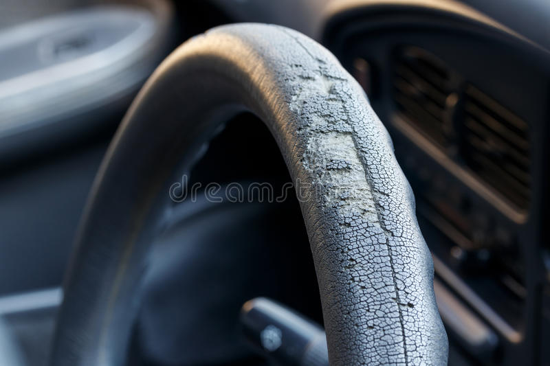 Old steering wheel leather stock images