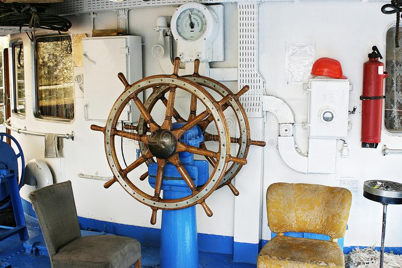 The old steering wheel of the ship. stock photo