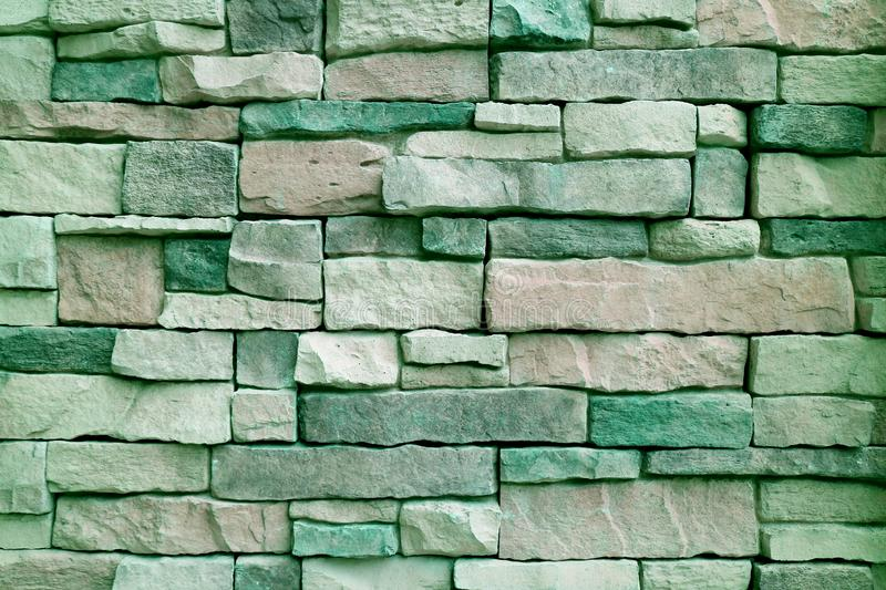 Old Stone Block Wall in Green Color Tone for Background or Banner stock photo