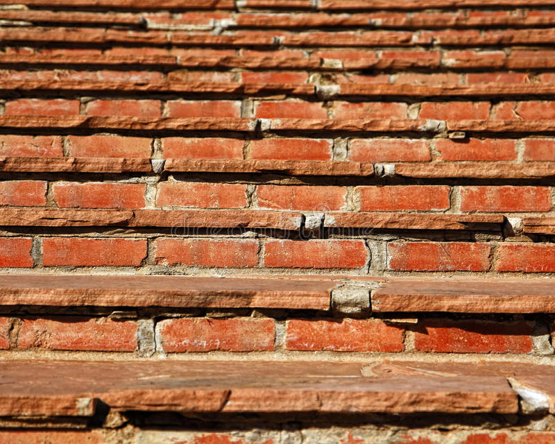 Old Stone and Brick Steps. Close up of old stone and brick steps leading up (shallow depth of field) - can represent goals to accomplish, obstacles to overcome stock photography