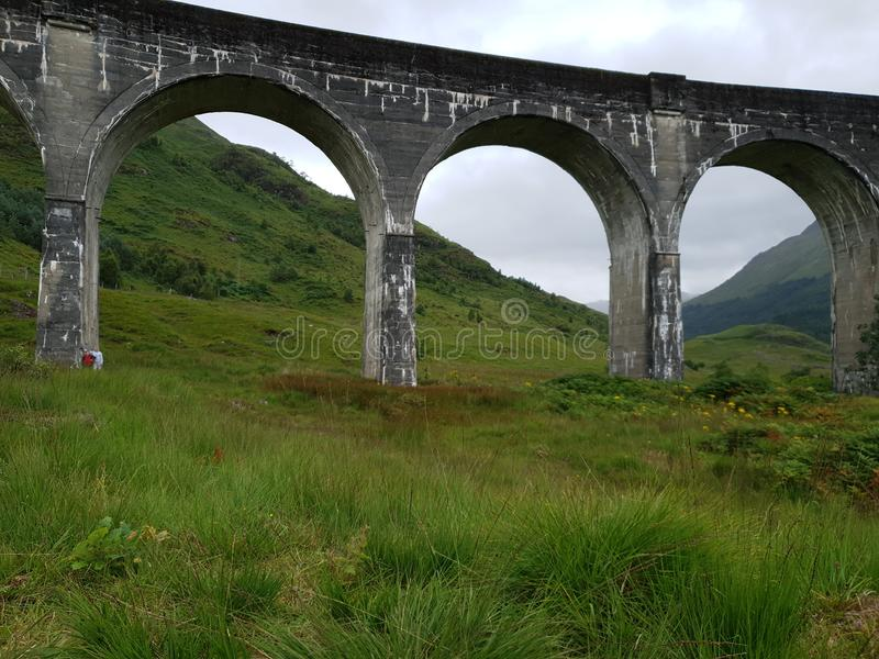 Old Stone bridge Harry Potter train Glenn. Mountain and Forest green landscapes stock images