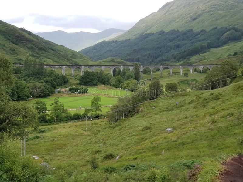 Old Stone bridge Harry Potter train Glenn. Mountain and Forest green landscapes stock photos