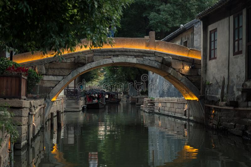 Old stone bridge over the canal in chinese village, Suzhou royalty free stock images
