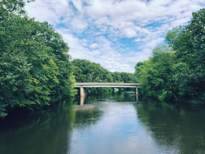 An old stone bridge over Farmington River. In Simsbury, Connecticut,United States royalty free stock photo
