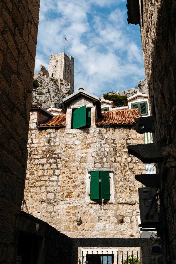 The old stone building and the Mirabella fort Peovica in the town of Omis, Croatia stock photos