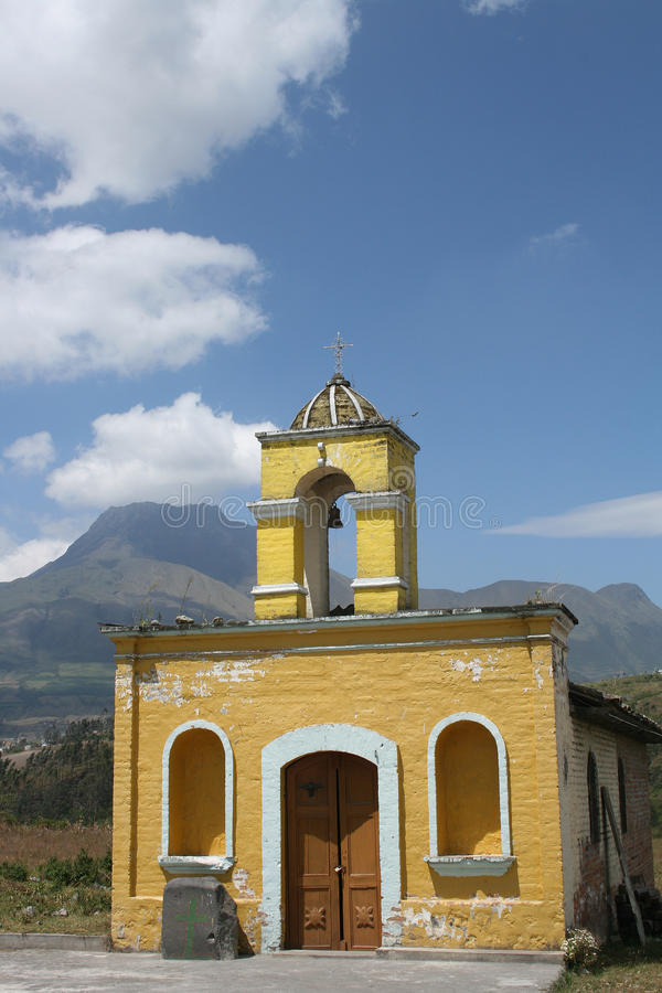 Old Stone Church in Cotacachi Ecuador. An old yellow stone Catholic Church in Cotacachi Ecuador with Mount Imbabura in the distance royalty free stock photo