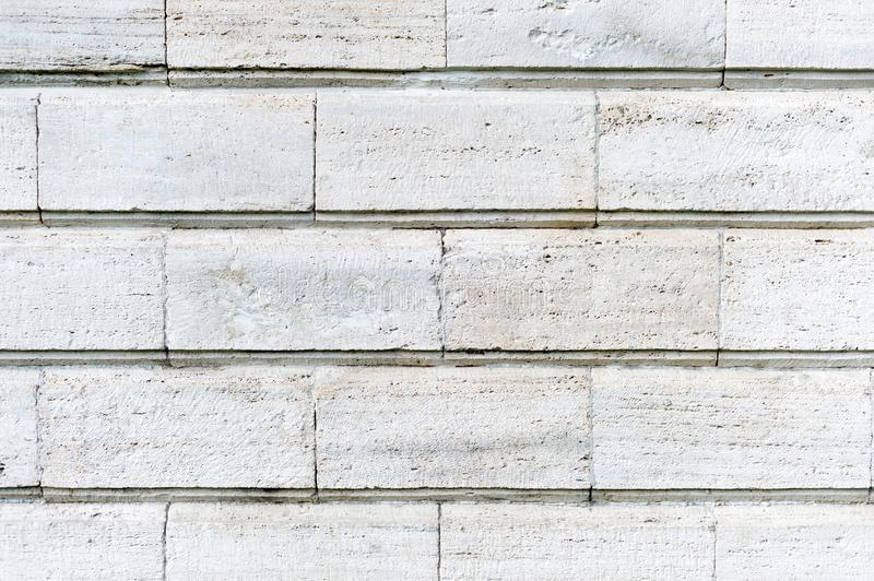 Old stone cladding plates on the wall closeup stock photos