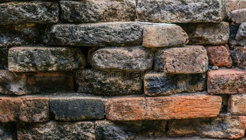 Old stone. Closeup Old stone wall blackground stock image