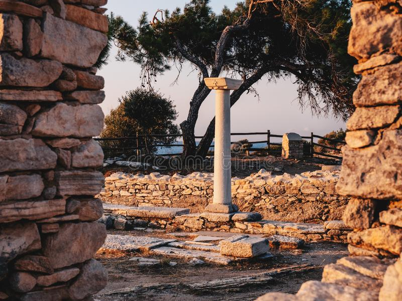 Old stone column in the ruins of the ancient Aliki stone quarry and marble port, Thasos stock images
