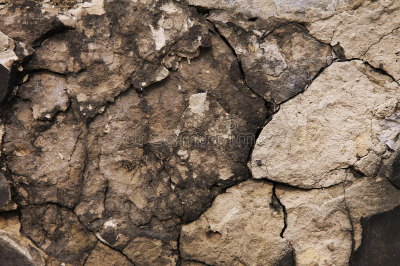 Old stone in the cracks stock image