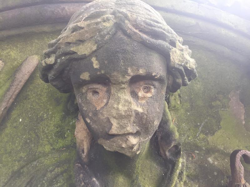 Old stone face. Of justice in a wall stock photos
