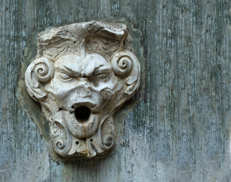 The old stone face on the wall of the castle in Lisbon. City royalty free stock photography