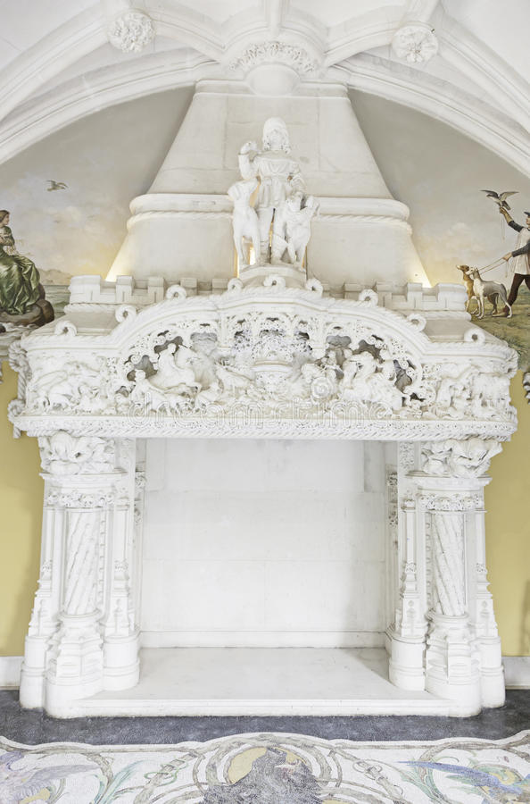 Old stone fireplace decorated. Interior detail of a monuento, ancient architecture stock image