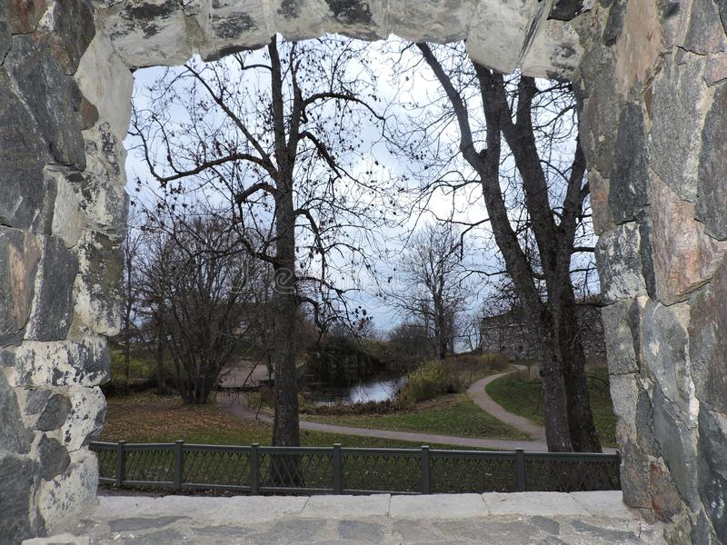 View from window of fortress on the park with pond, Sveaborg, Finland royalty free stock photography