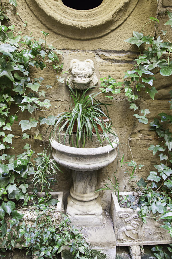 Old stone fountain stock photography