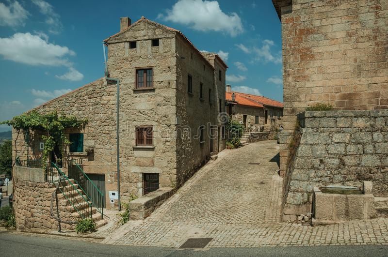 Old stone houses on a corner of deserted alley in Monsanto stock image