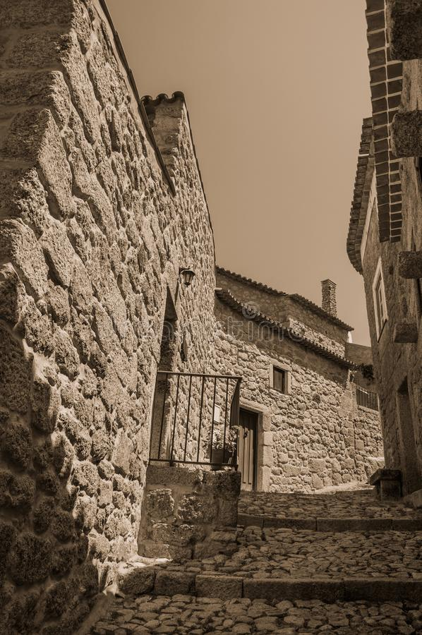 Old stone houses in deserted alley with steps at Monsanto stock photography
