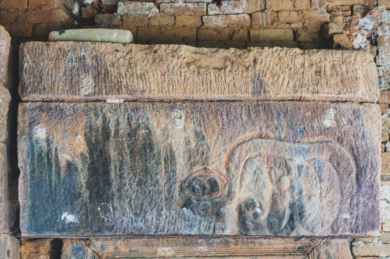 Old stone lintel at Ku Phra Kona, Roi Et province, Northeastern Thailand. Old stone lintel at Ku Phra Kona, group of Khmer prangs or pagodas built in the 11th royalty free stock photos